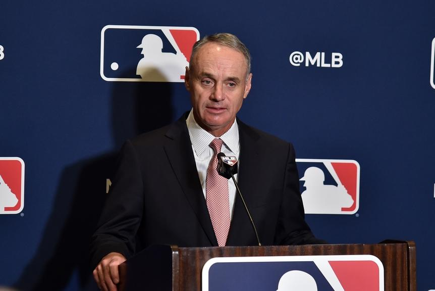Rob Manfred at podium in front of MLB logo