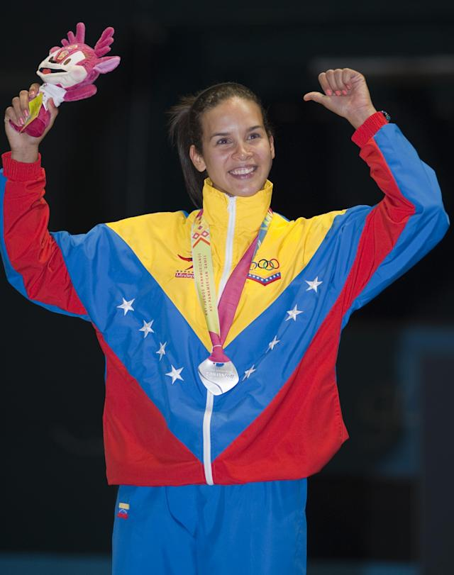 Alejandra Benitez of Venezuela celebrates after receiving the silver medal at the Medal Ceremony of the women's individual sabre during the Guadalajara 2011 Pan American Games, at the Fencing stadium in Guadalajara, Mexico, on October 25, 2011. AFP PHOTO/OMAR TORRES (Photo credit should read OMAR TORRES/AFP/Getty Images)