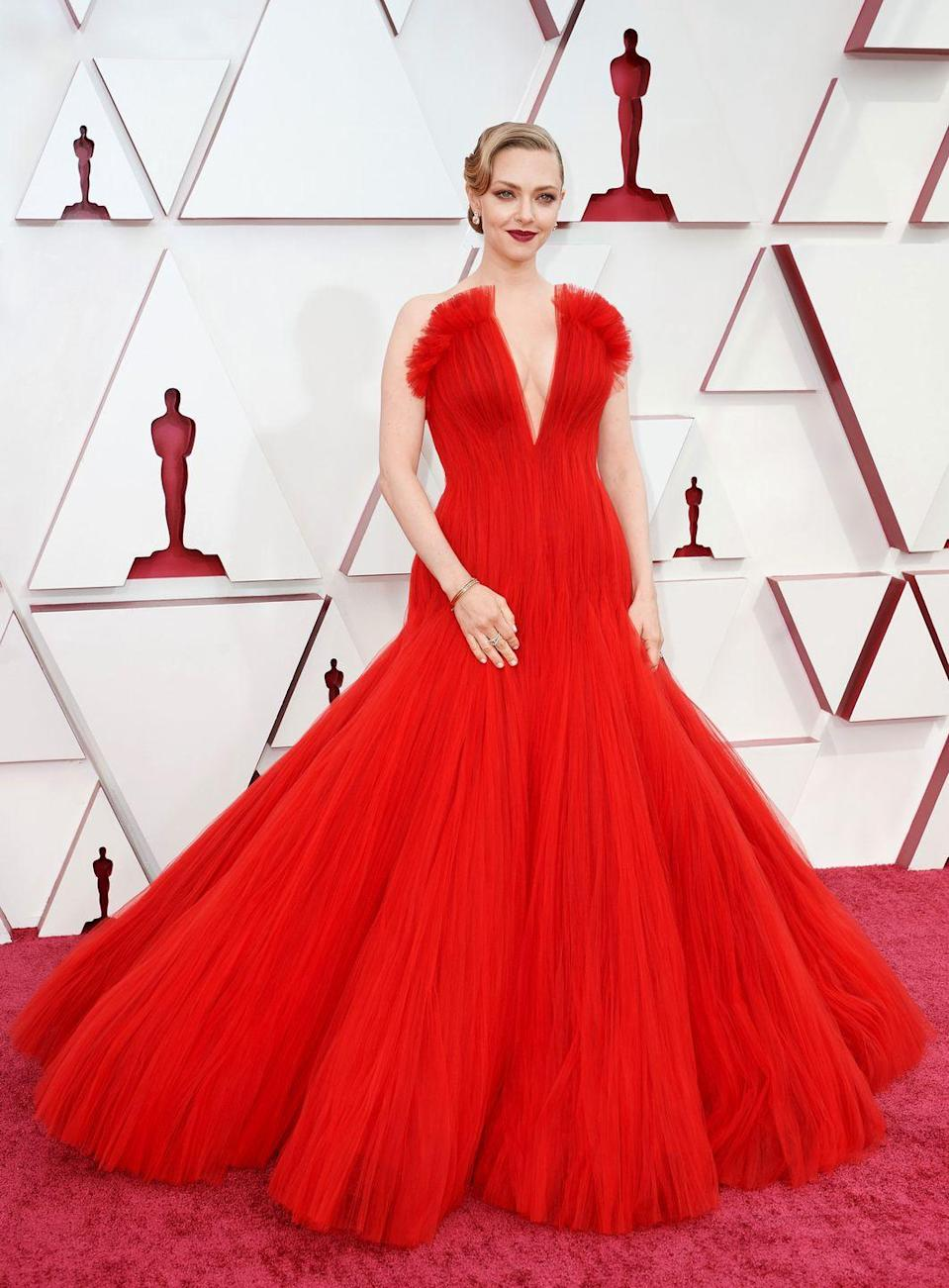 <p>The Academy Awards often calls for the most dramatic gowns from the couture catwalks and this was certainly the case for Amanda Seyfried and her stylist Elizabeth Stewart, who chose this beautiful red tulle design by Giorgio Armani Privé. The actress complemented the old Hollywood glamour of the gown with a matching red lip and a wavy updo.</p>