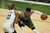 Milwaukee Bucks' Giannis Antetokounmpo tries to drive past Brooklyn Nets' Nicolas Claxton during the first half of Game 3 of the NBA Eastern Conference basketball semifinals game Thursday, June 10, 2021, in Milwaukee. (AP Photo/Morry Gash)