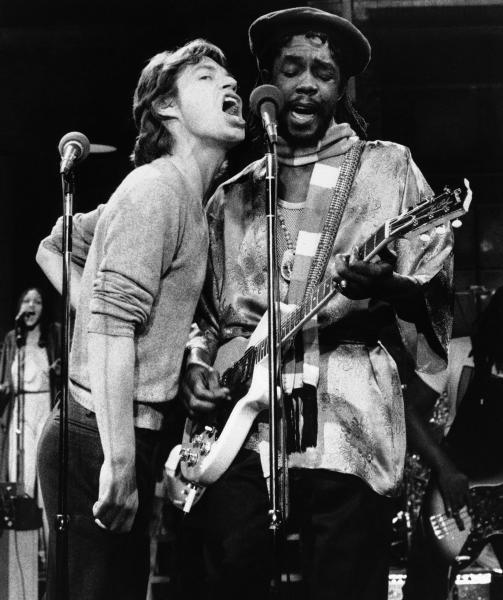 """FILE - In this Dec. 16, 1978 file photo, Mick Jagger, left, of the Rolling Stones, joins Jamaica's reggae musician Peter Tosh during a rehearsal for NBC's ?Saturday Night Live,"""" program in New York. For his musical contributions, Tosh's daughter, Niambe, received on Monday, Oct. 15, 2012, the posthumous """"Order of Merit"""" for her father, during the island's annual national heroes ceremony. Tosh, a founding member of the reggae band The Wailers along Bob Marley and Bunny Wailer, was killed in 1987 at age 42 by robbers who broke into his Jamaican home. (AP Photo/File)"""