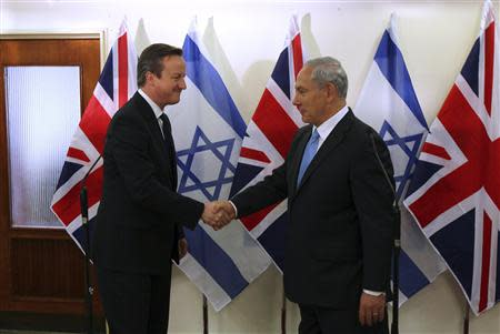 British Prime Minister Cameron shakes hands with his Israeli counterpart in Jerusalem