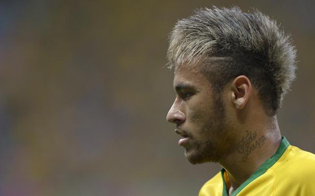 Brazil's Neymar pauses during the World Cup quarterfinal soccer match between Brazil and Colombia at the Arena Castelao in Fortaleza, Brazil, Friday, July 4, 2014. (AP Photo/Manu Fernandez)