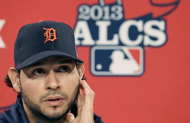 Detroit Tigers starting pitcher Anibal Sanchez listens to a reporter's question during an availability before the baseball team's workout at Fenway Park in Boston, Friday, Oct. 11, 2013. The Tigers will face the Boston Red Sox in Game 1 of the American League championship series on Saturday. (AP Photo/Charlie Riedel)