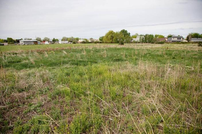 This field in Boise behind Shamrock Avenue will become Whitney Commons, an affordable housing subdivision featuring 11 newly constructed homes for sale and one remodeled home for rent.