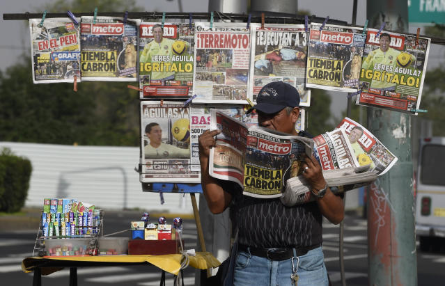 <p>A vendor reads a newspaper on the streets of Mexico City on Sept. 8, 2017 after the country was hit with a powerful earthquake. (Photo: Alfredo Estrella/AFP/Getty Images) </p>