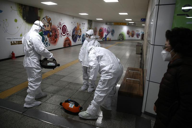 SEOUL, SOUTH KOREA - FEBRUARY 21: Disinfection workers wearing protective gears spray anti-septic solution against the coronavirus (COVID-19) at the subway station on February 21, 2020 in Seoul, South Korea. South Korea reported 52 new cases of the coronavirus (COVID-19) bringing the total number of infections in the nation to 156, with the potentially fatal illness spreading fast across the country. (Photo by Chung Sung-Jun/Getty Images) (Photo: Chung Sung-Jun via Getty Images)
