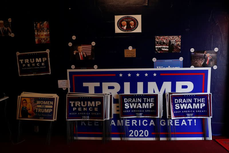 Campaign signs for U.S. President Donald Trump sit inside the Republican headquarters in Union City, Pennsylvania