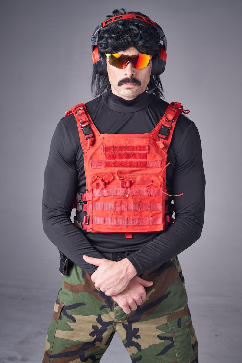 """Guy """"Dr Disrespect"""" Beahm is 6-foot, 8-inches tall, wears a mullet, headphones and sunglasses while he streams to his 4 million Twitch followers."""