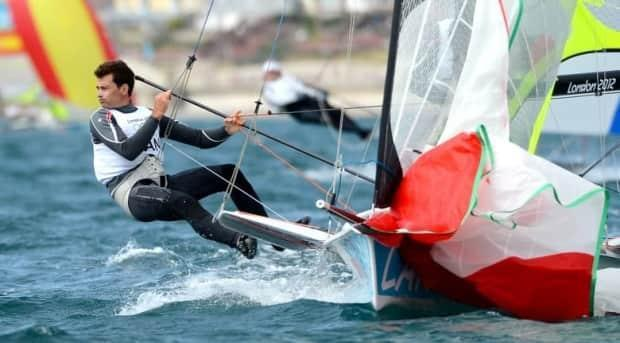 Toronto's Gordon Cook, left, and Vancouver's Hunter Lowden drop their spinnaker in the men's 49er sailing class at the Olympics in 2012. ( - image credit)