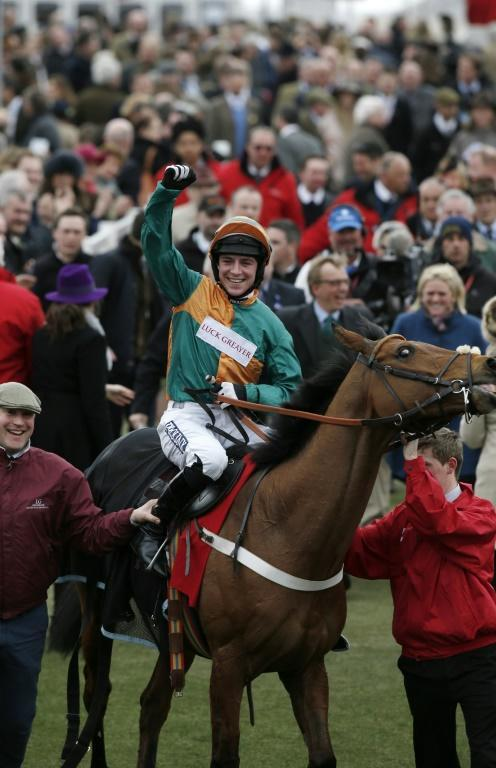 Gavin Sheehan paid tribute to his late grandfather who inspired him to take up riding when he won on Simply The Betts on the third day of the Cheltenham Festival (AFP Photo/ADRIAN DENNIS)