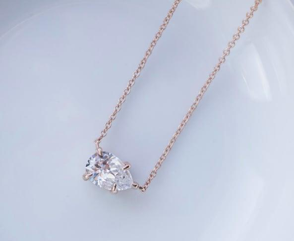 <p>This stunning <span>Diamond Nexus East-West Pear Necklace</span> ($320, originally $400) comes in white gold, yellow gold, or rose gold. The asymmetrical design is undeniably cool.</p>