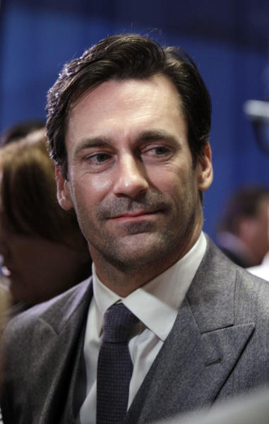 "FILE - Jon Hamm, of AMC's ""Mad Men"" television show, is interviewed on the New York Stock Exchange trading floor, in this March 21, 2012 file photo. The show is scheduled to premiere its new season Sunday. ""I've been around long enough to remember the Big Eight,"" the Missouri alum (Class of '93) told Associated Press television writer Lynn Elber. ""Then we're in the Big 12. And now we're in the SEC, which is really weird for me because this is our first season, and our football team just got destroyed. (AP Photo/Richard Drew, File)"