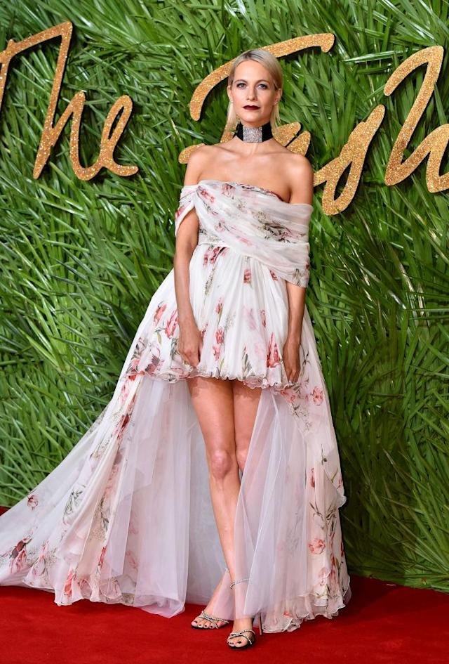 <p>Poppy Delevingne proves the cold-shoulder trend can work in the winter, as she rocked a floral asymmetric gown for the Fashion Awards. (Photo: Getty Images) </p>