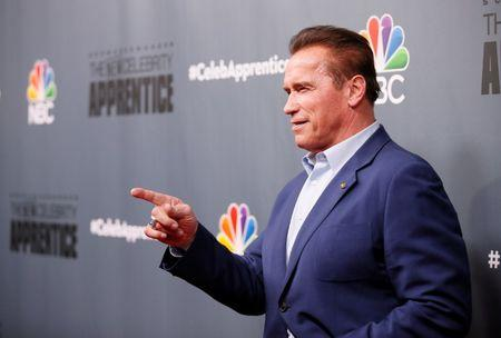 "Host Arnold Schwarzenegger poses after a panel for ""The New Celebrity Apprentice"" in Universal City"