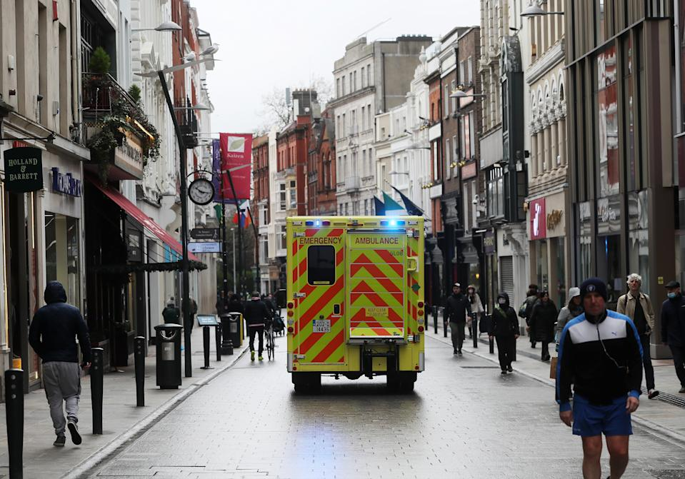 An ambulance drives down Grafton Street in Dublin's city centre as a nationwide lockdown remains in place. The last week of January saw 317 deaths linked to Covid-19, more than 10% of all deaths up to that point. New data from the Central Statistics Office (CSO) shows that more than 250 people died of the virus every week in the three weeks up to January 29. Picture date: Friday February 5, 2021.
