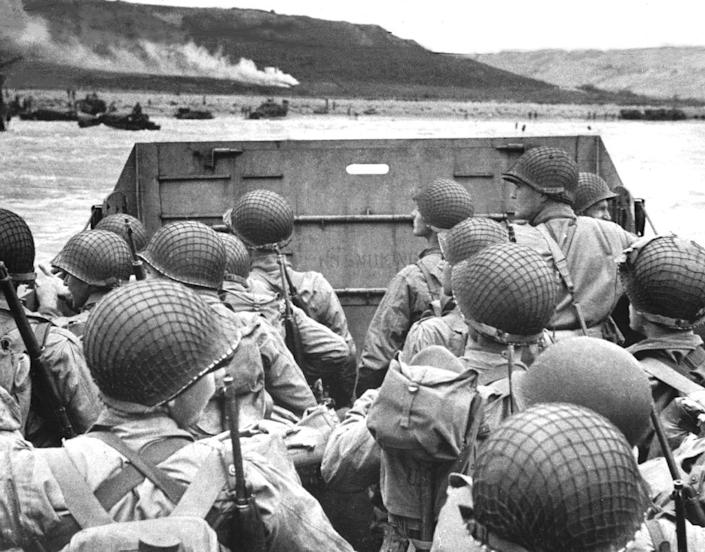 """American shock troops huddle behind the protective front of a landing craft as it nears the beachhead on the Normandy coast of France (Omaha Beach) in front of Vierville-sur-Mer, June 6, 1944. (Photo by Photo12/UIG/Getty Images)American shock troops huddle behind the protective front of a landing craft as it nears the beachhead on the Normandy coast of France American shock troops huddle behind the protective front of a landing craft as it nears the beachhead on the Normandy coast of France (Omaha Beach) in front of Vierville-sur-Mer, June 6, 1944.<span class=""""copyright"""">Photo12/UIG—Getty Images</span>"""
