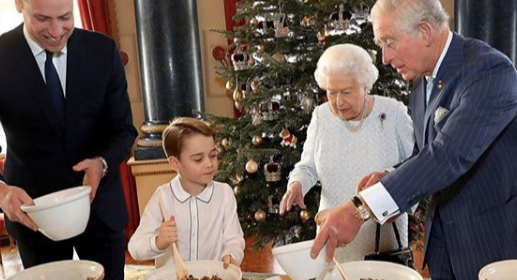Prince George made Christmas puddings with the Queen, Prince Charles ad Prince William [Image: Getty]