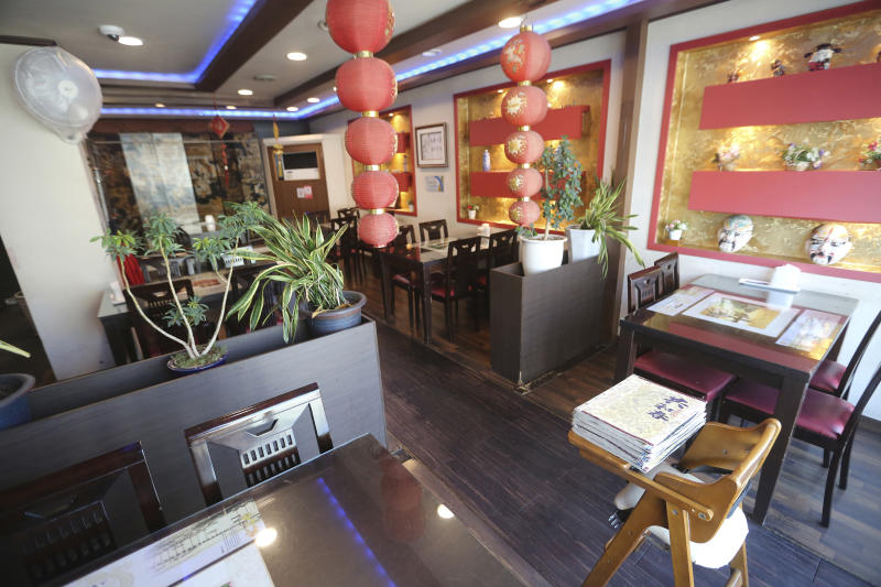 HOLD FOR USE WITH STORY SLUGGED CHINA OUTBREAK FEAR GOES VIRAL- In this Feb. 14, 2020 photo, an empty Chinese restaurant is seen at the Chinatown in Incheon, South Korea.(AP Photo/Ahn Young-joon)