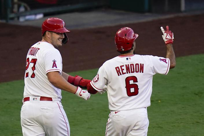 Angels' Anthony Rendon celebrates his two-run home run with Mike Trout.