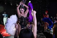 Performers flaunted poses for an ecstatic audience, powered by a pounding house music soundtrack