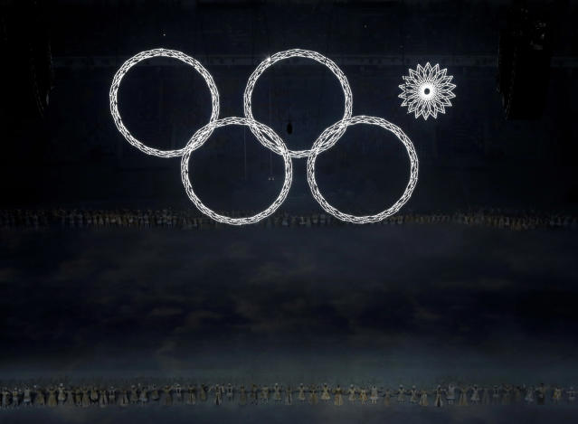 One of the Olympic rings fails to open during the opening ceremony of the 2014 Winter Olympics in Sochi, Russia. (AP Photo)