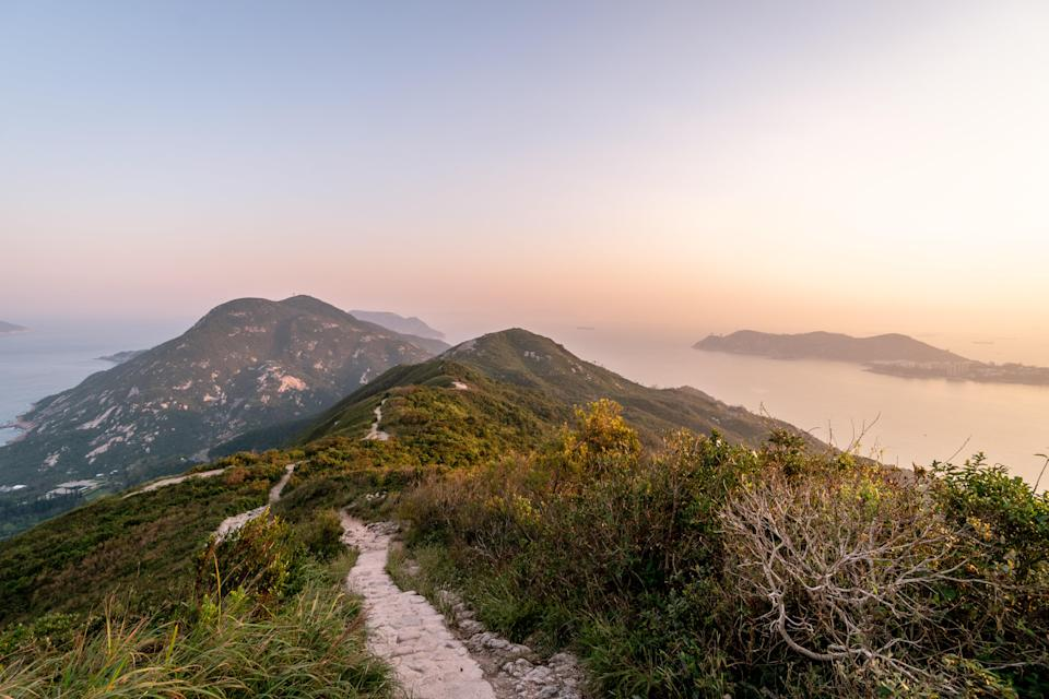 """""""This mutable air sign needs to keep their mind stimulated,"""" says White. """"But if they're over-stimulated, they can easily spin out."""" For that reason, White likes <a href=""""https://www.cntraveler.com/destinations/hong-kong?mbid=synd_yahoo_rss"""" rel=""""nofollow noopener"""" target=""""_blank"""" data-ylk=""""slk:Hong Kong"""" class=""""link rapid-noclick-resp"""">Hong Kong</a>: The buzzing metropolis offers the twins a thrill a minute with its dynamite <a href=""""https://www.cntraveler.com/gallery/best-restaurants-in-hong-kong?mbid=synd_yahoo_rss"""" rel=""""nofollow noopener"""" target=""""_blank"""" data-ylk=""""slk:restaurant"""" class=""""link rapid-noclick-resp"""">restaurant</a> and <a href=""""https://www.cntraveler.com/gallery/best-shops-in-hong-kong?mbid=synd_yahoo_rss"""" rel=""""nofollow noopener"""" target=""""_blank"""" data-ylk=""""slk:shopping"""" class=""""link rapid-noclick-resp"""">shopping</a> scenes, not to mention plenty of temples and gardens. To recharge, hike the <a href=""""https://www.cntraveler.com/activities/hong-kong/dragons-back?mbid=synd_yahoo_rss"""" rel=""""nofollow noopener"""" target=""""_blank"""" data-ylk=""""slk:Dragon's Back"""" class=""""link rapid-noclick-resp"""">Dragon's Back</a> from Chai Wan on the eastern side of Hong Kong Island or take a ferry to chill <a href=""""https://www.cntraveler.com/activities/hong-kong/lamma-island?mbid=synd_yahoo_rss"""" rel=""""nofollow noopener"""" target=""""_blank"""" data-ylk=""""slk:Lamma Island"""" class=""""link rapid-noclick-resp"""">Lamma Island</a>, blessed with fishing villages and largely empty beaches."""