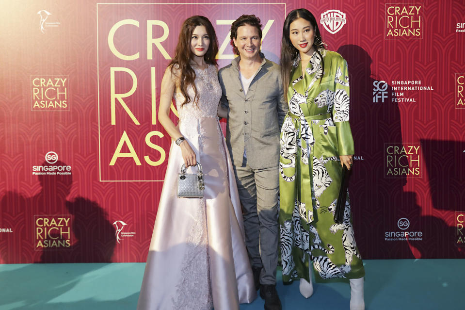 <p>Producer of 'Crazy Rich Asians' John Penotti (centre) and guests at the Singapore premiere of 'Crazy Rich Asians' on 21 August 2018. (PHOTO: Yahoo Lifestyle Singapore) </p>