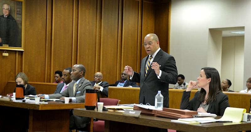 William Hill, attorney for the Estate of Dr. Martin Luther King Jr. Inc., speaks during court proceedings in Fulton County Superior Court on Wednesday, Feb. 19, 2014, in Atlanta, as Eric Barnum, attorney for Bernice King, seated center, listens. The case puts brothers Martin Luther King III and Dexter King against Bernice King over the possession of their father's Nobel Peace Prize and personal Bible. The brothers are seeking a restraining order against their sister, Bernice. (AP Photo/Atlanta Journal-Constitution, Kent D. Johnson) MARIETTA DAILY OUT; GWINNETT DAILY POST OUT; LOCAL TV OUT; WXIA-TV OUT; WGCL-TV OUT.