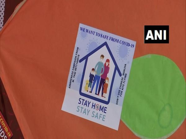 Kites with messages of staying safe from COVID-19 made by kite-maker Mohammad Taqi in Delhi. [Photo/ANI]