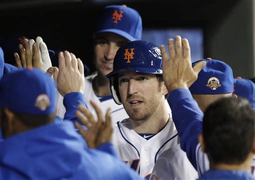 New York Mets' Ike Davis celebrates with teammates after hitting a home run during the seventh inning of a baseball game against the Miami Marlins, Friday, Sept. 21, 2012, in New York. (AP Photo/Frank Franklin II)
