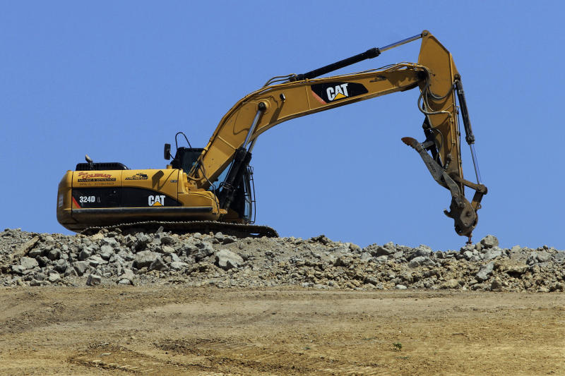 "FILE - In this Wednesday, June 20, 2012, file photo a caterpillar machine is used at the Clinton Landfill in Clinton, Ill. Caterpillar cut its profit and revenue guidance on Monday, Oct. 22, 2012, saying the world's economic conditions ""are weaker than we had previously expected."" Caterpillar Inc. is the world's largest construction and mining equipment maker, so its results are watched closely as a sign of where the broader economy is headed. (AP Photo/Seth Perlman, File)"