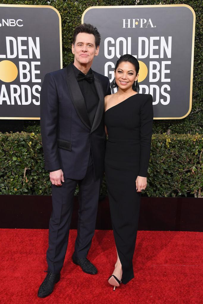 <p>Jim Carrey and actress Ginger Gonzaga, his co-star on best TV comedy nominee <i>Kidding</i>, revealed at a pre-Golden Globes bash that they're dating. Carrey was nominated for his performance in the Showtime series. (Photo: Getty Images) </p>