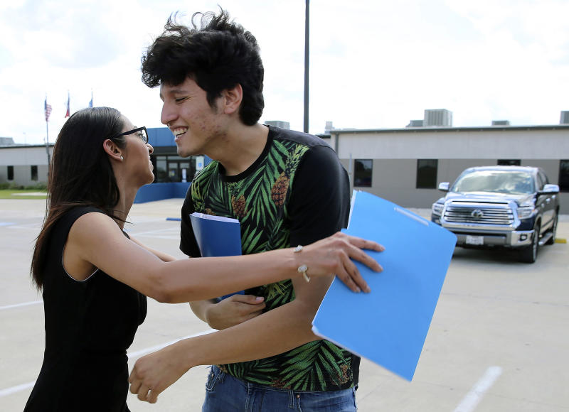 U.S. citizen Francisco Galicia, 18, gets a hug from his attorney, Claudia Galan, after his release from the South Texas Detention Facility in Pearsall, Texas, Tuesday, July 23, 2019. Galicia was released from immigration custody Tuesday after wrongfully being detained for more than three weeks. Galicia lives in the border city of Edinburg, Texas, and was traveling north with a group of friends when they were stopped at a Border Patrol inland checkpoint. According to Galan and the Dallas Morning News, agents apprehended Galicia on suspicion that he was in the U.S. illegally even though he had a Texas state ID. (Kin Man Hui/The San Antonio Express-News via AP)
