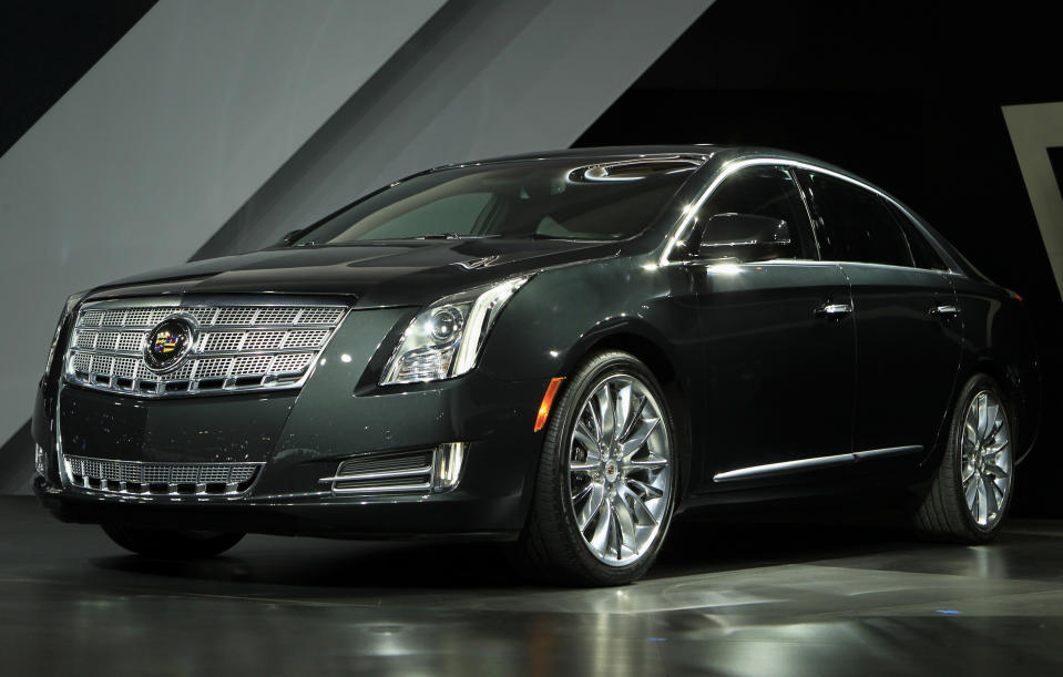 The Cadillac 2013 XTS is unveiled at the LA Auto Show in Los Angeles, California, November 16, 2011. REUTERS/Lucy Nicholson (UNITED STATES - Tags: BUSINESS TRANSPORT)