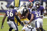 Pittsburgh Steelers running back James Conner (30) pushes in to score on a touchdown run against the Baltimore Ravens during the second half of an NFL football game, Sunday, Nov. 1, 2020, in Baltimore. (AP Photo/Gail Burton)