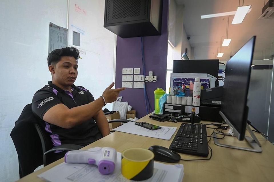 Senior brand ambassador Mohamad Fahmi Suhairi Suhaimi speaks during an interview with Malay Mail at Anytime Fitness in Shah Alam February 12, 2021. ― Picture by Yusof Mat Isa