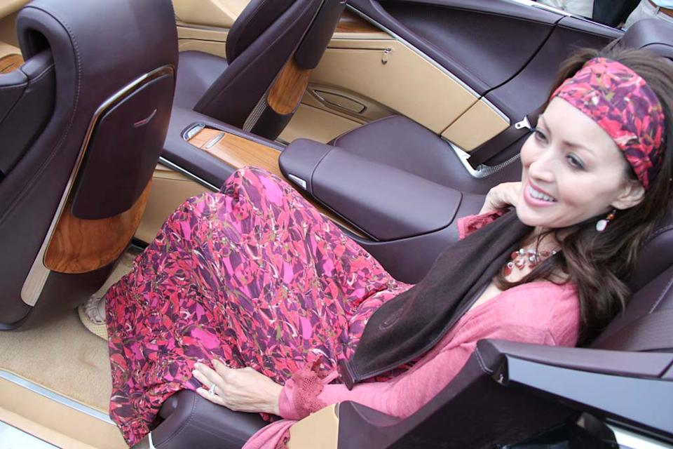 Rear seating features pull-out scarves for both passengers.