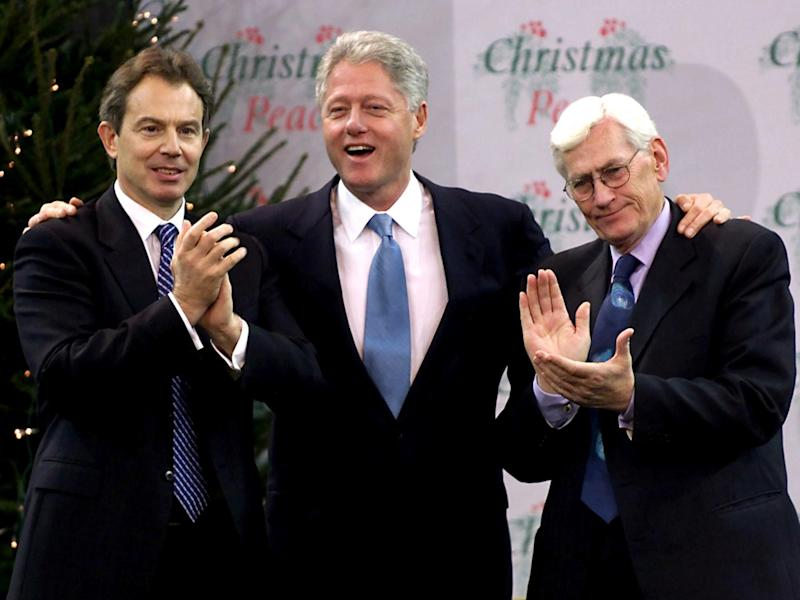 Bill Clinton is congratulated by British Prime Minister Tony Blair and Deputy First Minister for Northern Ireland Seamus Mallon after delivering a speech at Belfast's Odyssey Centre December 13, 2000: REUTERS