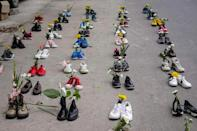 Shoes and flowers are displayed in Mandalay in a protest against the military coup