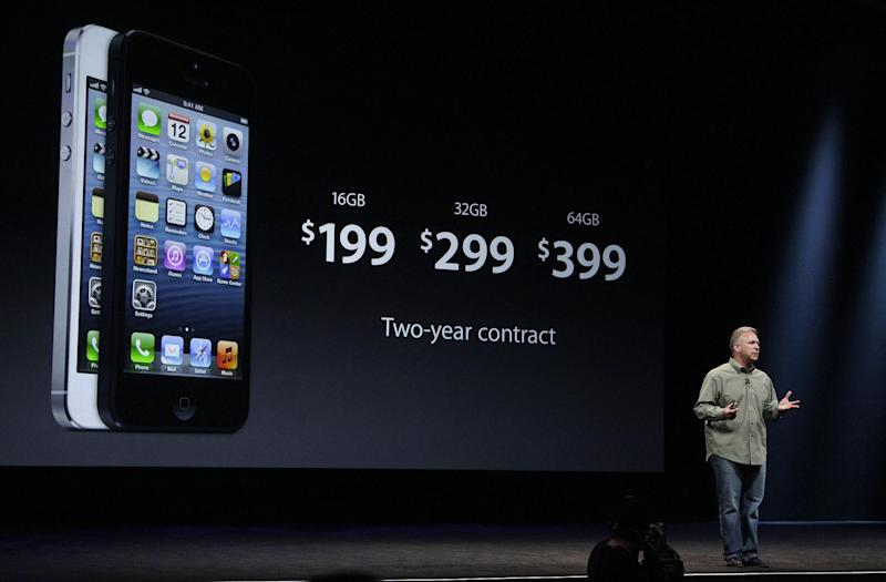 Phil Schiller, Apple's senior vice president of worldwide marketing, gives prices of the iPhone 5 during an Apple event in San Francisco, Wednesday, Sept. 12, 2012. (AP Photo/Jeff Chiu)