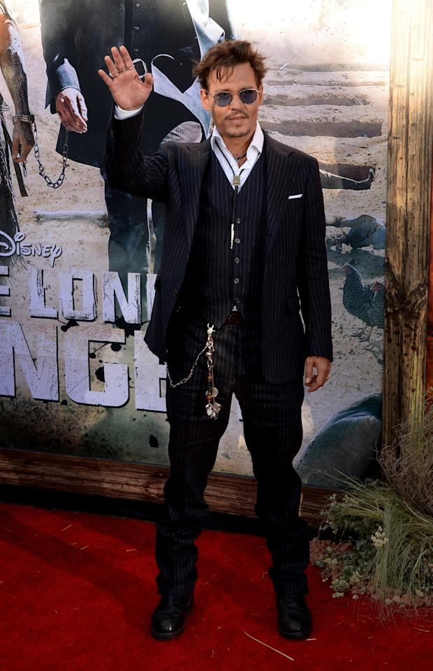 "ANAHEIM, CA - JUNE 22: Actor Johnny Depp attends the premiere of Walt Disney Pictures' ""The Lone Ranger"" at Disney California Adventure Park on June 22, 2013 in Anaheim, California. (Photo by Jason Merritt/Getty Images)"