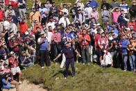 Team USA's Bryson DeChambeau watches his shot on the first hole during a four-ball match the Ryder Cup at the Whistling Straits Golf Course Friday, Sept. 24, 2021, in Sheboygan, Wis. (AP Photo/Jeff Roberson)