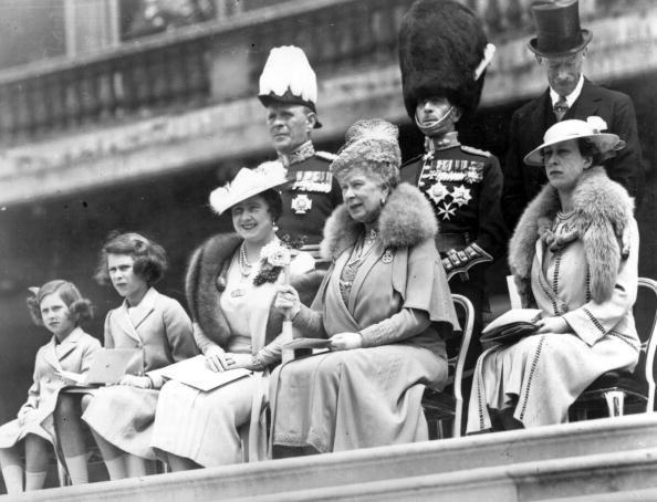 <p>Queen Elizabeth, King George VI, Queen Mary (center) and Princesses Elizabeth and Margaret observe the presentation of new colors to Grenadier Guards at Buckingham Palace. </p>