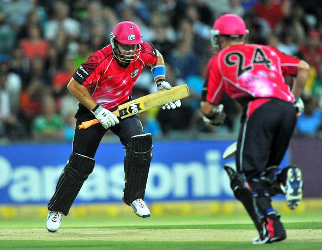 Michael Lumb (L) and Brad Haddin of the Sixers increase their runs during the Karbonn Smart CLT20 Final match between bizhub Highveld Lions and Sydney Sixers at Bidvest Wanderers Stadium on October 28, 2012 in Johannesburg, South Africa. (Photo by Duif du Toit/Gallo Images/Getty Images)