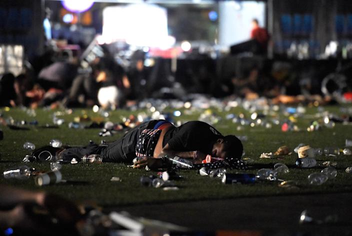 <p>A person lies on the ground at the Route 91 Harvest country music festival after apparent gun fire was heard on Oct. 1, 2017 in Las Vegas, Nevada. There are reports of an active shooter around the Mandalay Bay Resort and Casino. (Photo: David Becker/Getty Images) </p>