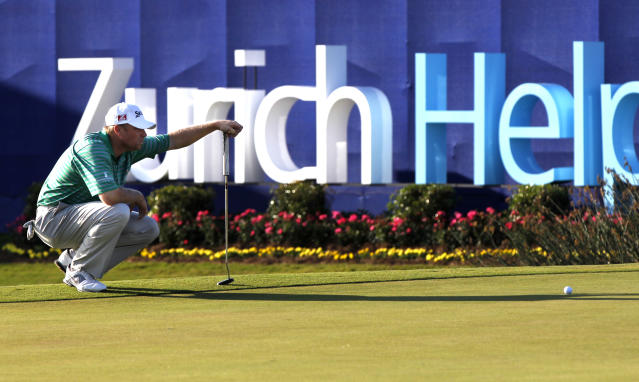 John Rollins lines up a shot on the 9th hole during the second round of the Zurich Classic golf tournament at TPC Louisiana in Avondale, La., Friday, April 27, 2012. (AP Photo/Gerald Herbert)