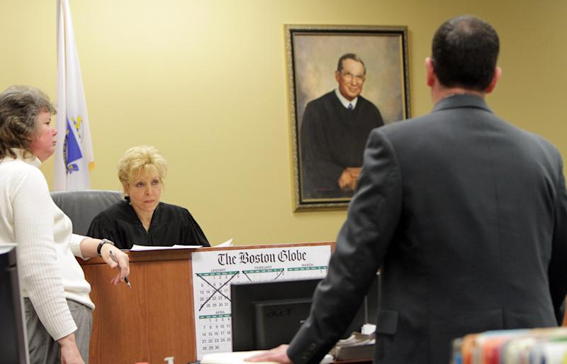 Judge Rowan Sragow, center, listens to prosecutor Patrick Fitzgerald, right, during a hearing for Irish nanny Aisling McCarthy Brady at Cambridge District Court in Medford, Mass., Friday, March 22, 2013. During the hearing, where Brady stood in a hallway and was not visible to the courtroom, the judge delayed her probable cause hearing. Brady's lawyer argued against the postponement and Brady's $500,000 bail. Sragow didn't reduce bail and set the next proceeding for April 22. (AP Photo/Irish Independent, Chitose Suzuki, Pool)