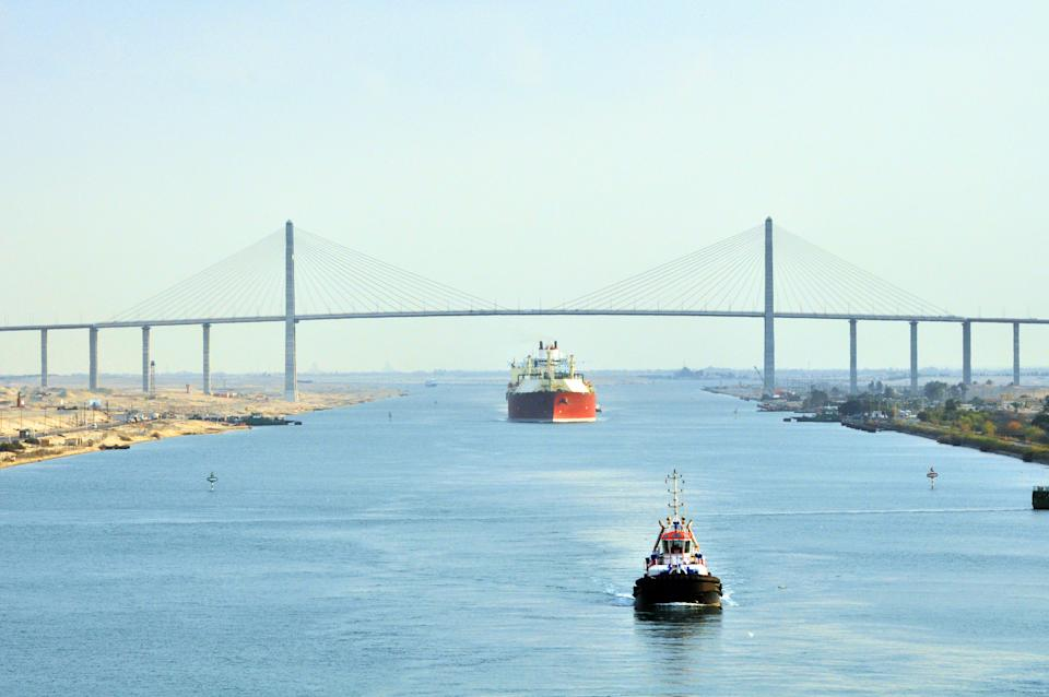 An LNG tanker passing through the Suez Canal Bridge with a pilot boat in the foreground. An LNG carrier is a tank ship designed for transporting liquefied natural gas (LNG).