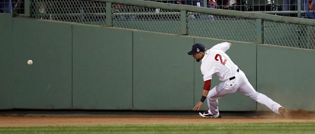 Boston Red Sox's Jacoby Ellsbury chases a ball hit by St. Louis Cardinals' Matt Holliday during the fourth inning of Game 2 of baseball's World Series Thursday, Oct. 24, 2013, in Boston. (AP Photo/Elise Amendola)